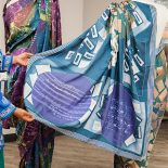 Displaying the pallu of the silk sari. Photo credit: Maddie Farris.
